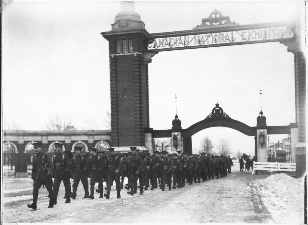 1914 - Troops passing under the second Dufferin Gate when Exhibition grounds were being used for training during World War I