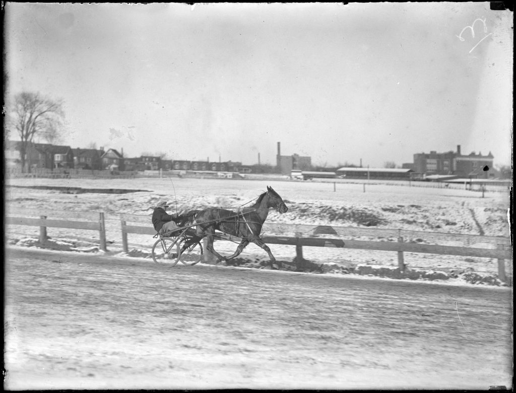 1933/46 - Horse and rider training at Dufferin Park - notice Kent Public School in the background