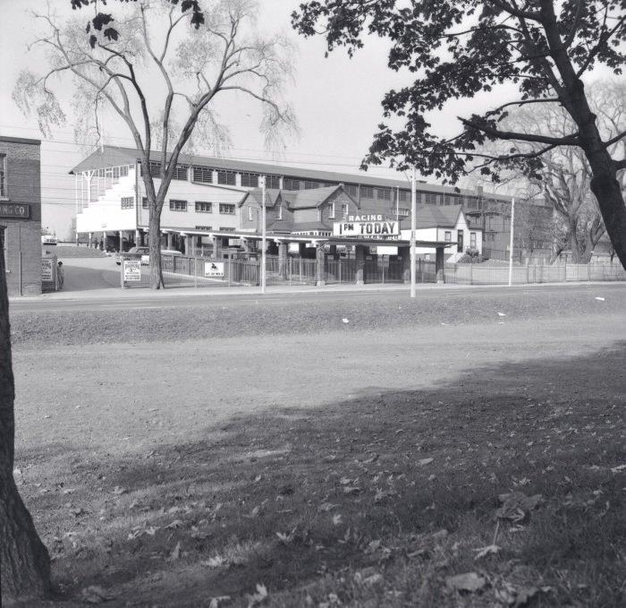 1955 - Looking northwest across Dufferin St from Dufferin Grove Park towards the grandstand of the racetrack