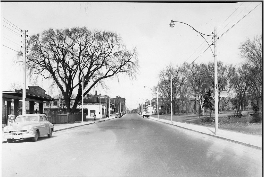 1951 - Looking north on Dufferin St towards Bloor St W - notice racetrack on left, Kent School in centre back and Dufferin Grove Park on right