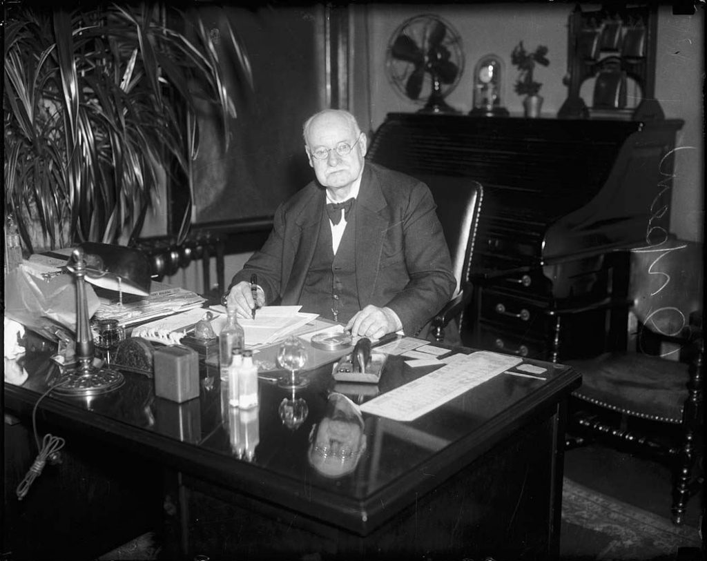 1910/40 - Fred Orpen, owner of Dufferin Park Racetrack, at his desk