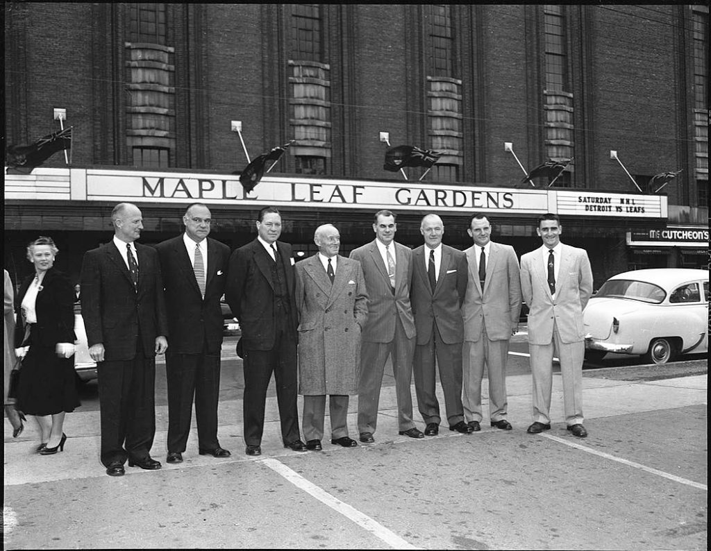 1950's - Conn Smythe (centre) and others in front of Maple Leaf Gardens