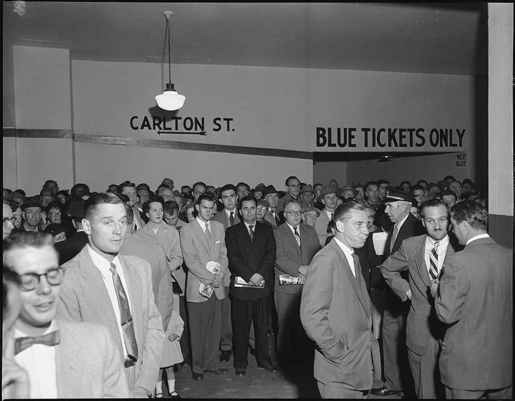 1955 - A crowd at the opening ceremony for the new escalators