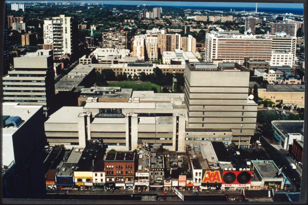 1990's - An aerial view of Yonge St between Gerrard E & Gould Sts, looking east