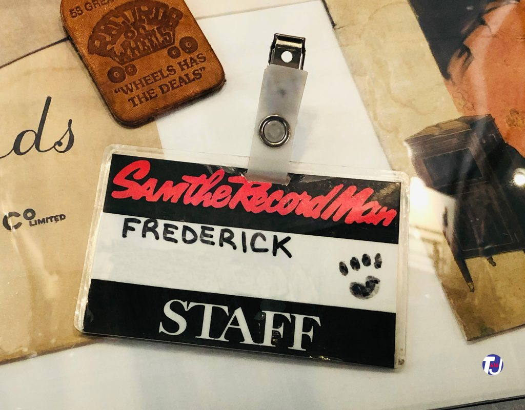 Sam the Record Man employee name tag displayed at the Friar's Music Museum