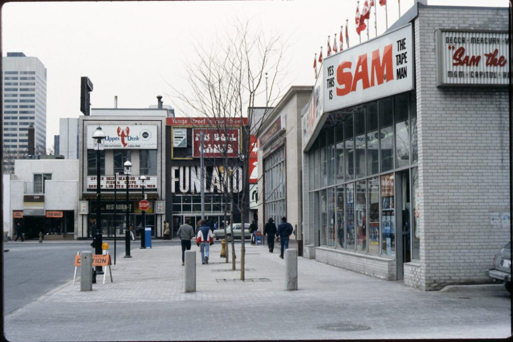 1980's - Sam the Tape Man, Fran's and Funland from Gould St, looking west towards Yonge St