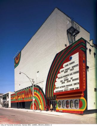 1969 - The exterior of the Uptown's Backstage Theatre entrance, looking northeast on Balmuto St