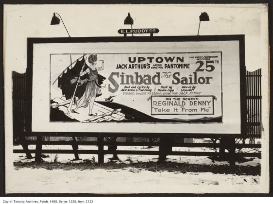 1920's - A billboard for the Uptown Theatre advertising a production of Jack Arthur's Annual Christmas Pantomime, Sinbad the Sailor