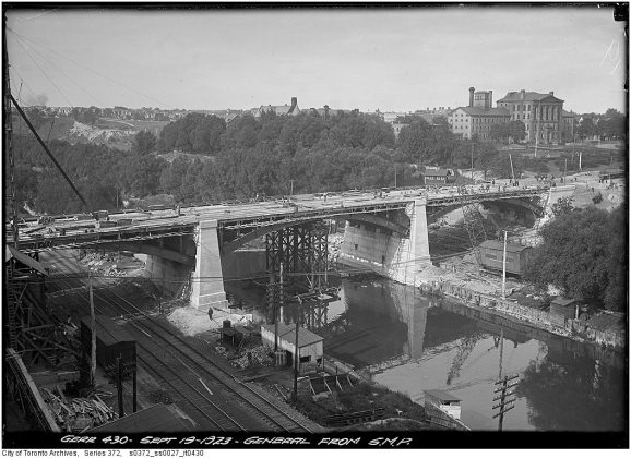 1923 - View of the Don Jail and construction of the Gerrard Street bridge from a sheet metal products building, looking northeast
