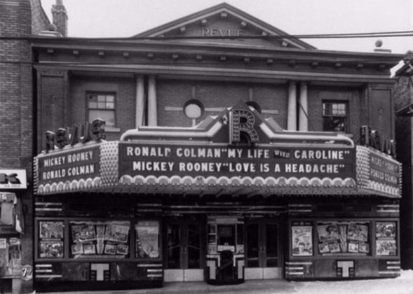 """1942 - The Revue Theatre and marquee advertising the films """"My Life With Caroline"""" and """"Love Is A Headache"""""""