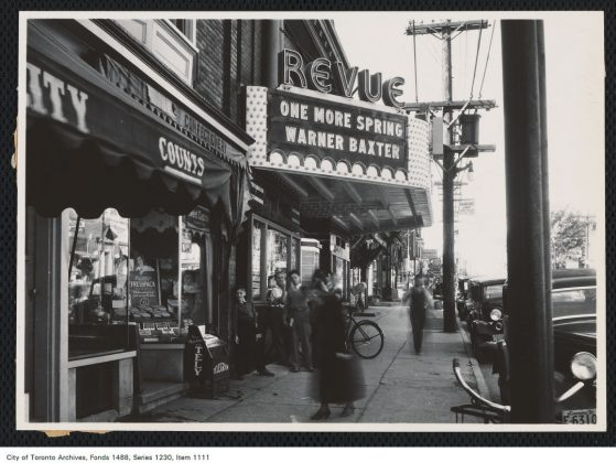 """1935 - The Revue Theatre and marquee advertising the film """"One More Spring"""", looking north on Roncesvalles Ave"""