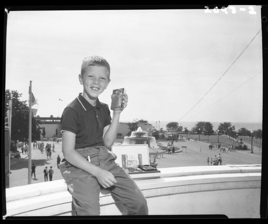 1960's - Boy listening to a transistor radio at the Canadian National Exhibition