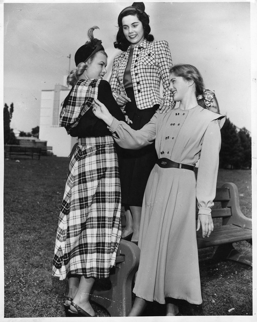 1940 - Models at the CNE wearing classic wartime attire that was both flattering to the silhouette yet featured masculine details