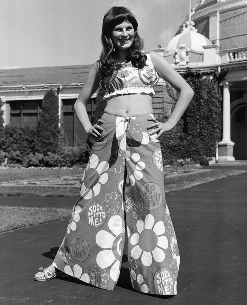 1960's - Psychedelic, over-the-top, flower-power patterned crop-top with ultra wide leg pants