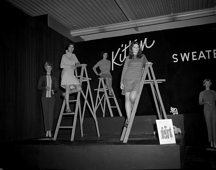 1960's - Kitten Sweaters brand worn by models standing on ladders at The Ex