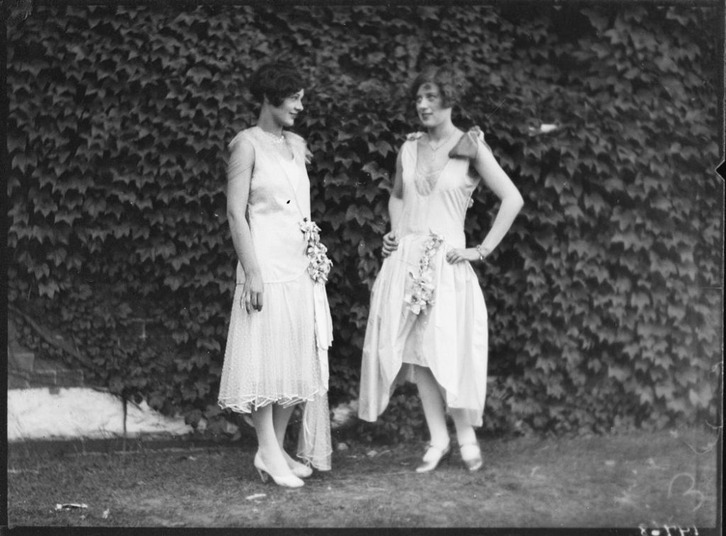 1928 - Two models - one wearing a pink silk dress and the other a blue taffeta dress at the CNE