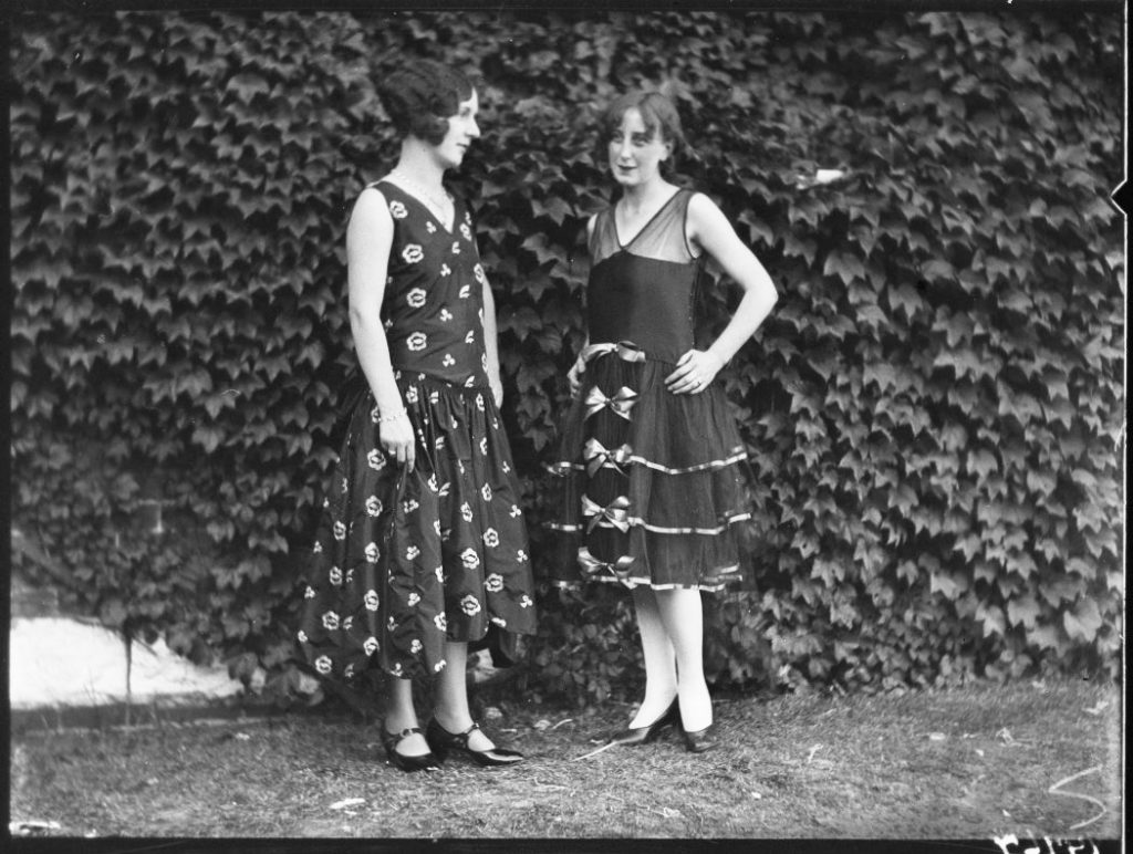 1926 - Two models - one wearing a red satin dress and the other a black taffeta dress at the CNE