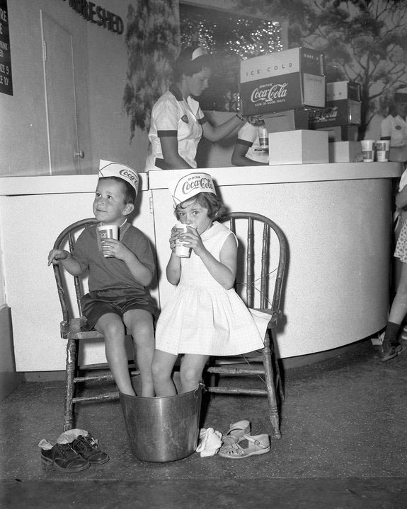 1959 - Taking a break at the Coca-Cola booth, at the Canadian National Exhibition