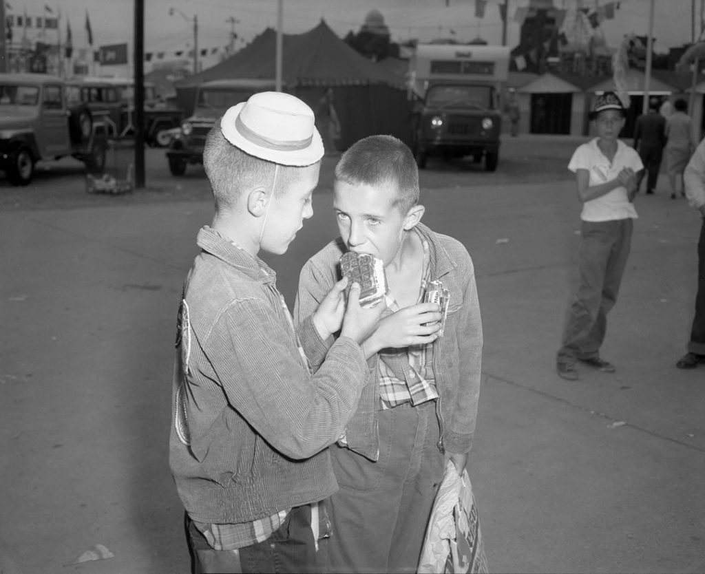 1961 - Sharing an ice cream waffle at The Ex