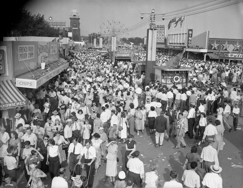 1961 - Crowds on The Midway and 15¢ ice cream waffles on right