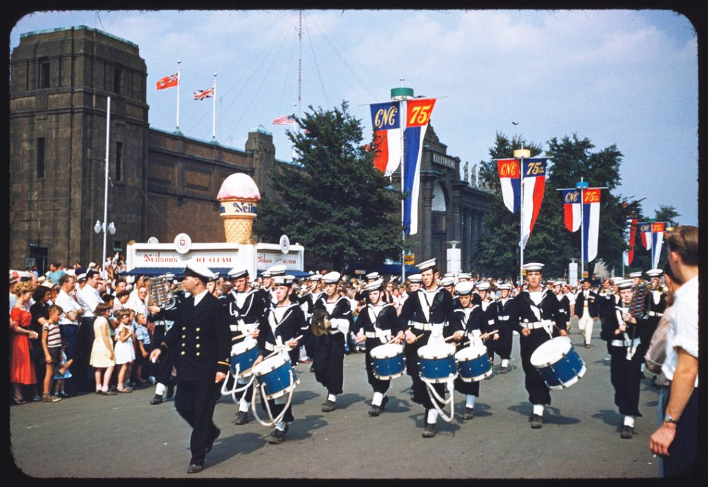 1953 - Royal Canadian Navy Band in the Warriors Day Parade at the CNE, Neilson's ice cream in the background