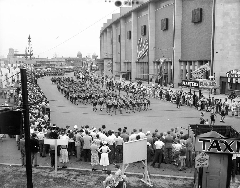 1955 - Boy Scouts Parade at Exhibition Place, passing by the north side of the Stadium