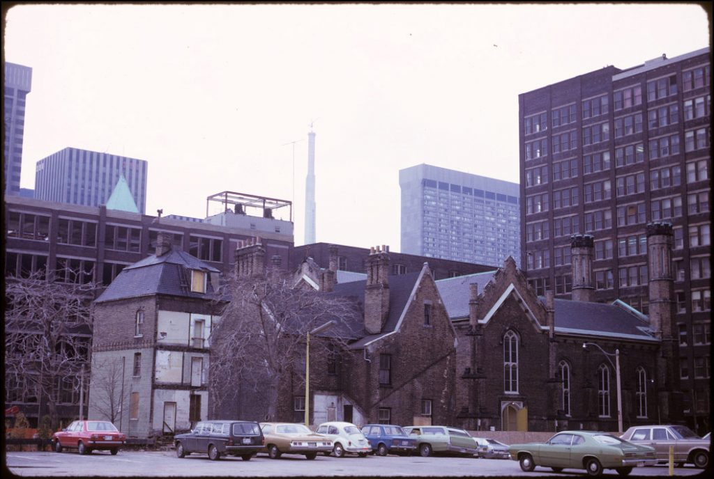 1974 - Scadding House, Rectory, Church of the Holy Trinity and construction of CN Tower, looking southwest