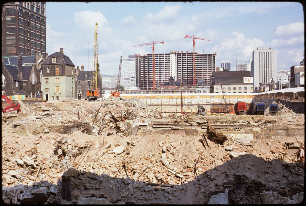 1974 - Scadding House and view of excavation/foundation of the Eaton Centre, looking north
