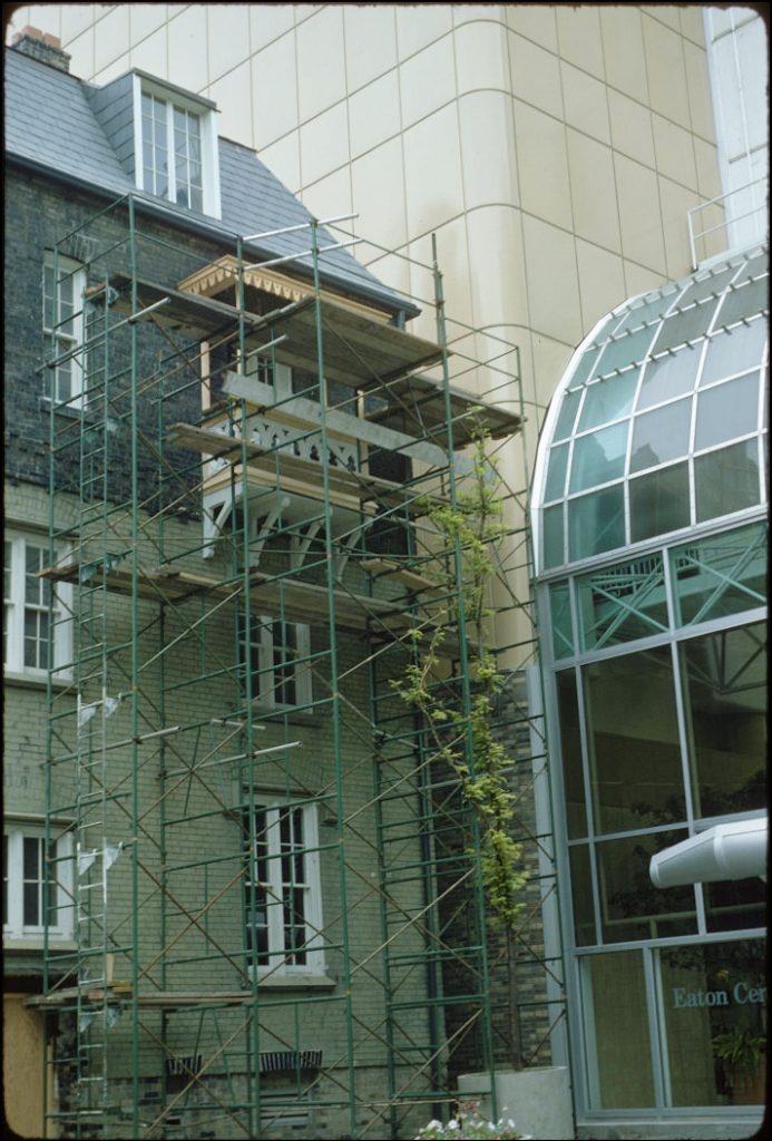 1977 - Scaffolding on the Scadding House, directly beside the west entrance of the Eaton Centre