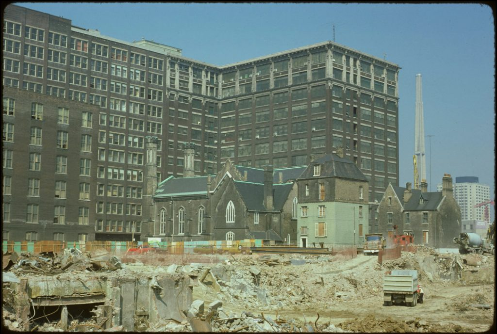 1974 - Scadding House, Church of the Holy Trinity, Rectory and view of excavation for the Eaton Centre, looking northwest