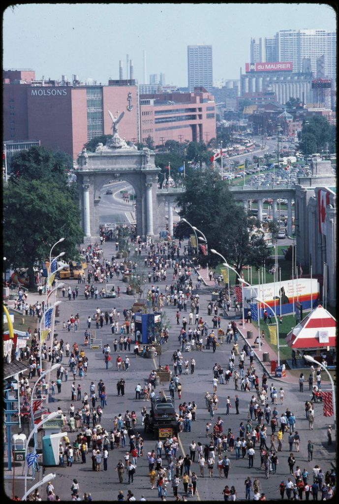 1981 - The CNE midway, Princes' Gates and Molson's brewery, looking east along Lake Shore Blvd W