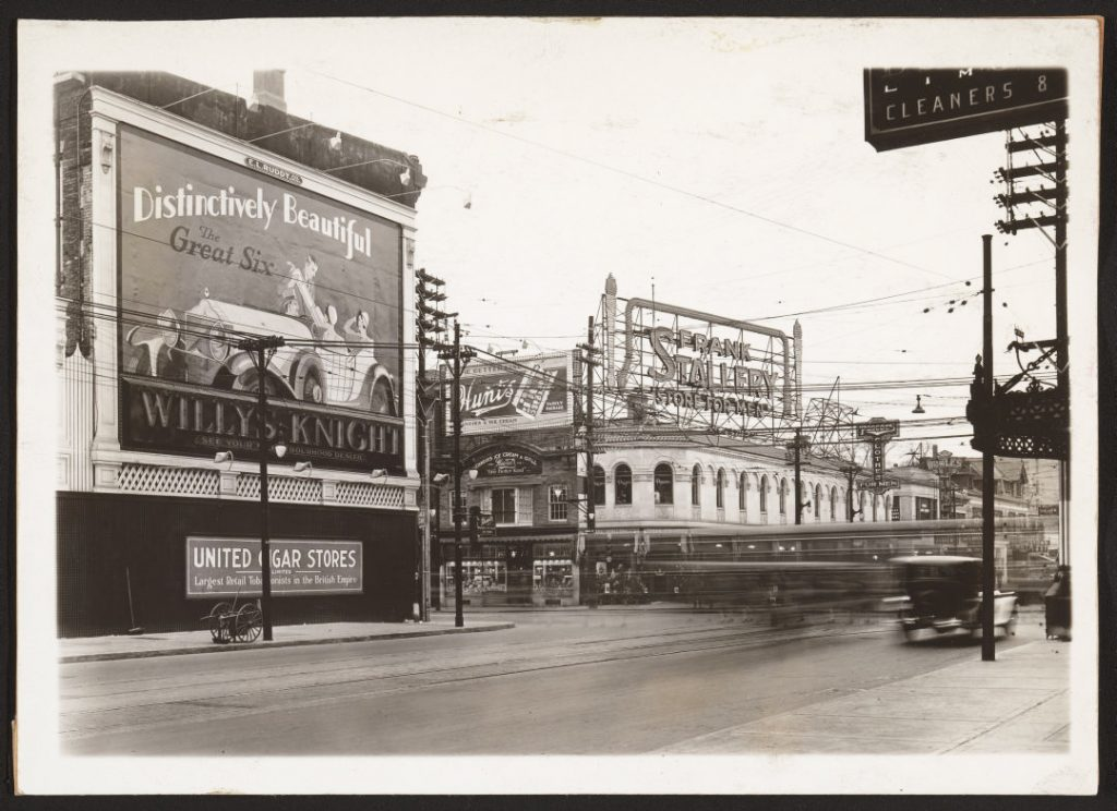 """1930/35 - Stollery's and """"Frank Stollery Store for Men"""" rooftop illuminated sign at Yonge and Bloor Sts, looking southwest"""