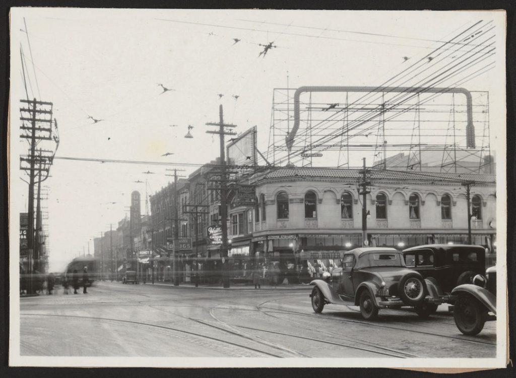 1930/35 - Frank Stollery shop and rooftop illuminated sign at Yonge and Bloor Sts, looking southwest