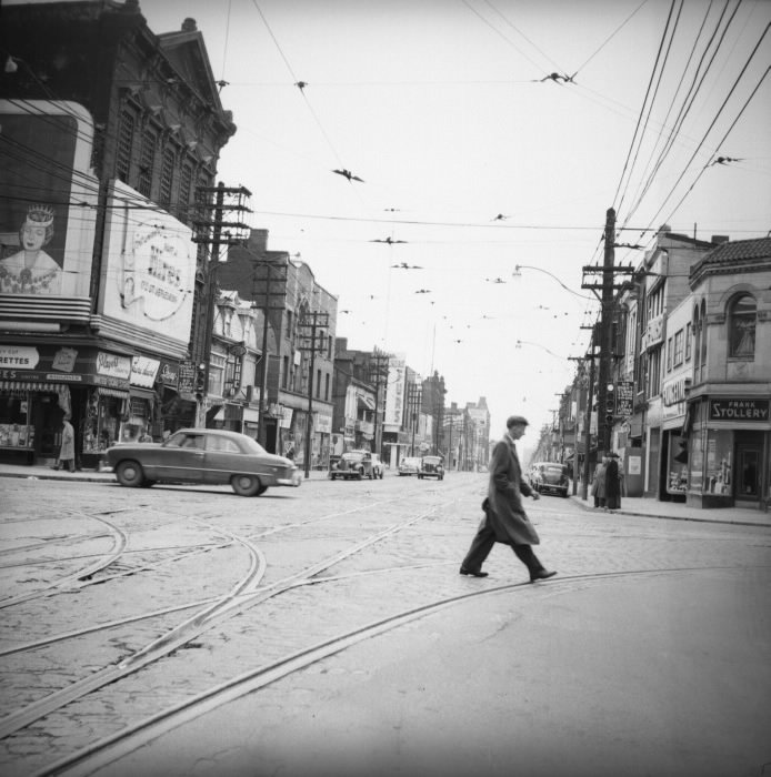 1953 - Looking south from Yonge and Bloor Sts, Stollery's is on the right
