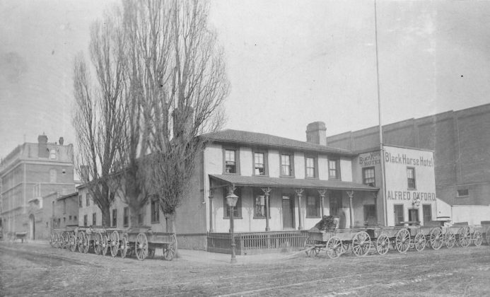 1885 - Black Horse Hotel once at Front St E and George St, northeast corner - building no longer exists