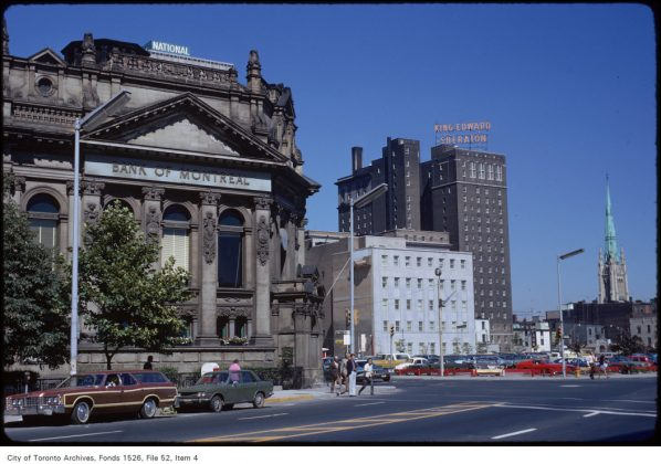 1973 - A view of the Bank of Montreal (today's Hockey Hall of Fame), the King Edward Hotel and the Cathedral of St James from Front & Yonge Sts, looking northeast