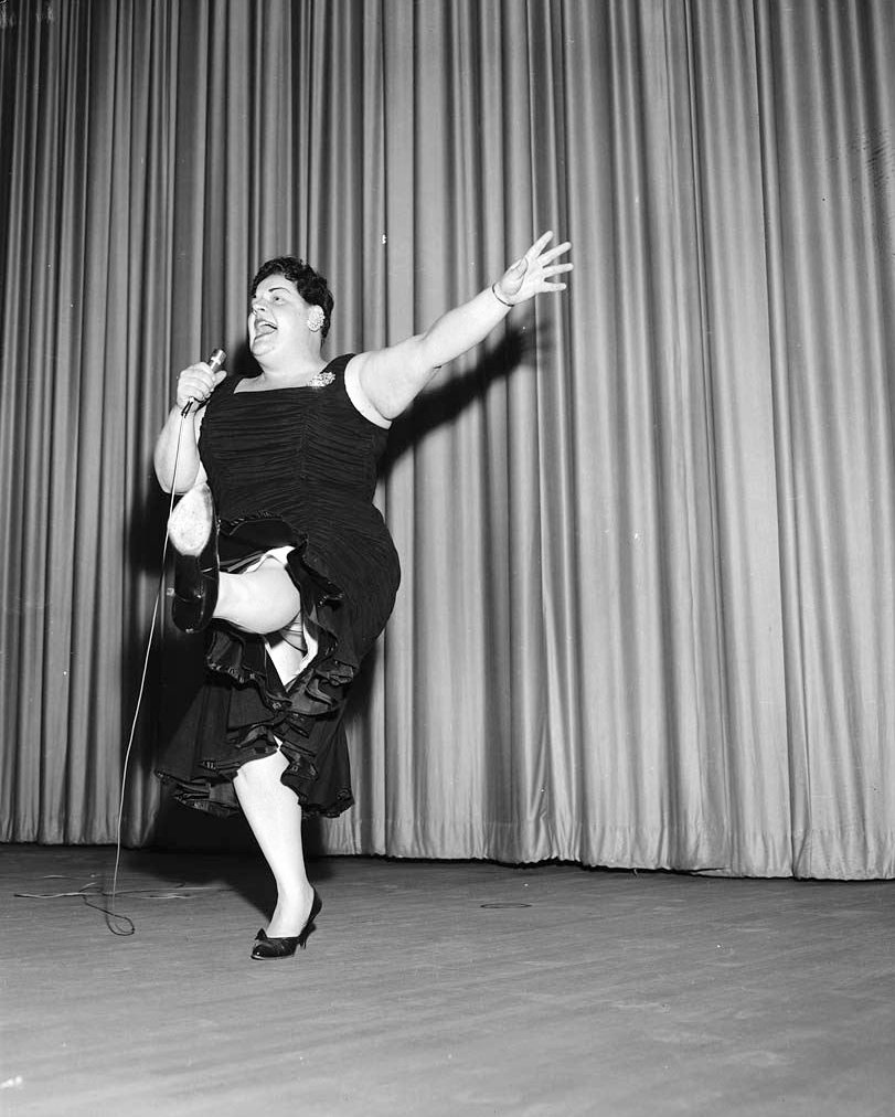 1959 - Kate Murtagh, American singer and actress, on stage at the Lux