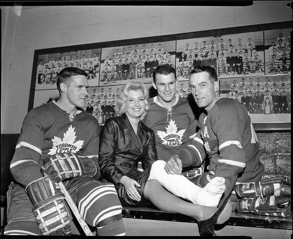 1950's - Toronto Maple Leafs players, including Tim Horton, and an ice capades performer with a broken leg