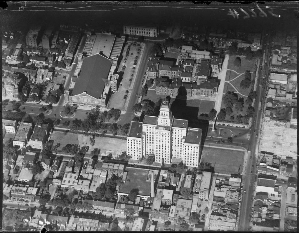 1930 - Aerial view of University Avenue Armouries and Canada Life Building with bare land on right being cleared for University Ave extension