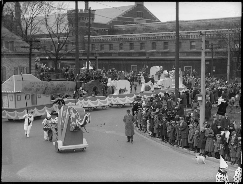 1926 - Eaton's Santa Claus Parade traveling past the University Avenue Armouries at Osgoode, Chestnut and Albert Sts