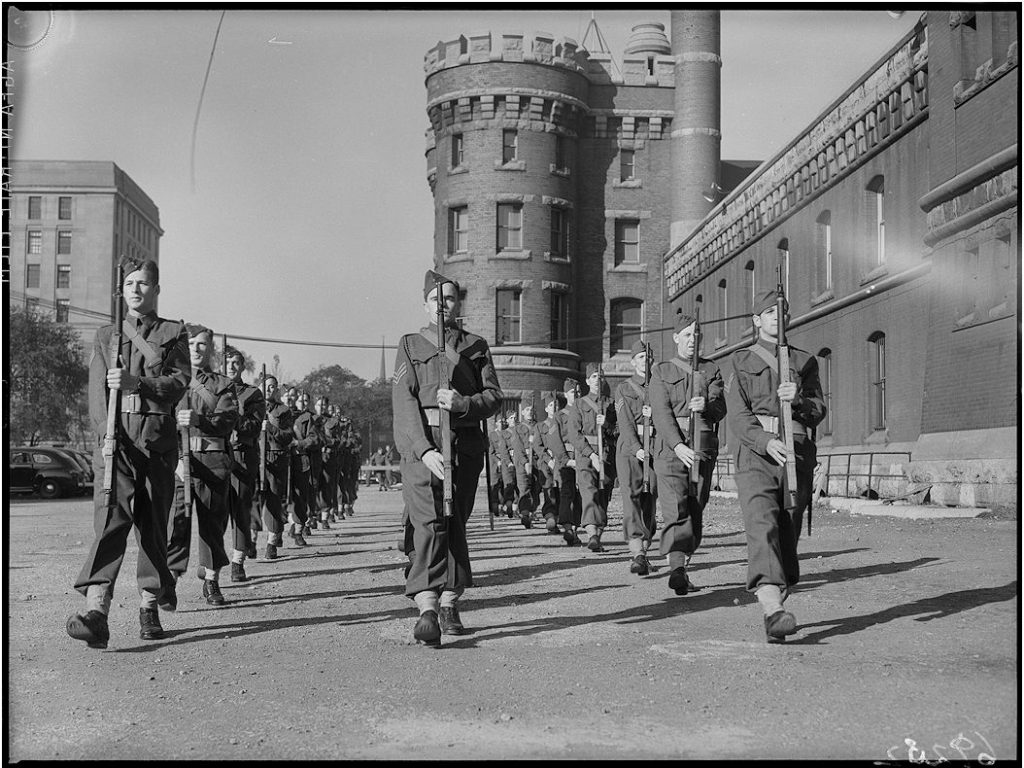1940 - Troops training, marching and presenting arms at the Armouries