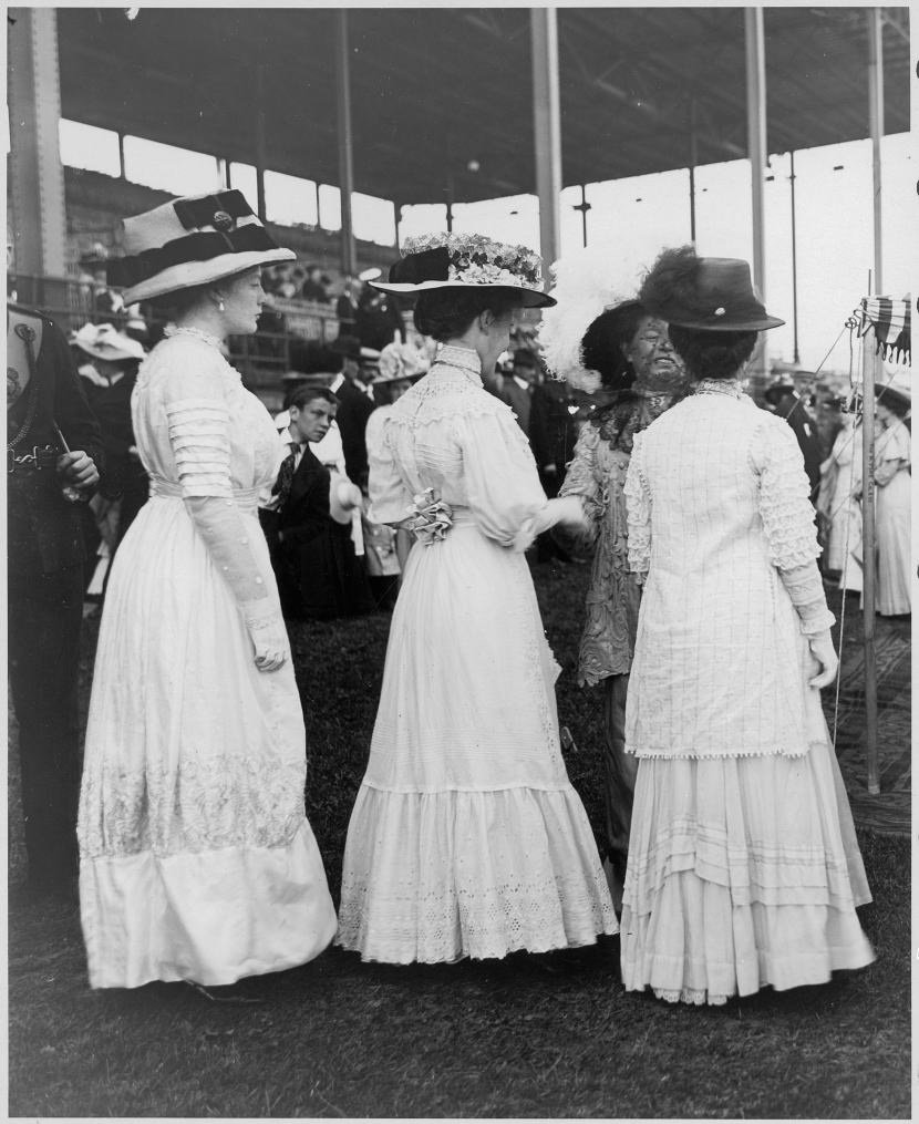 1910 - Ladies in tea dresses and elaborate hats at a reception on Exhibition grounds for Sir Henry and Lady Pellatt