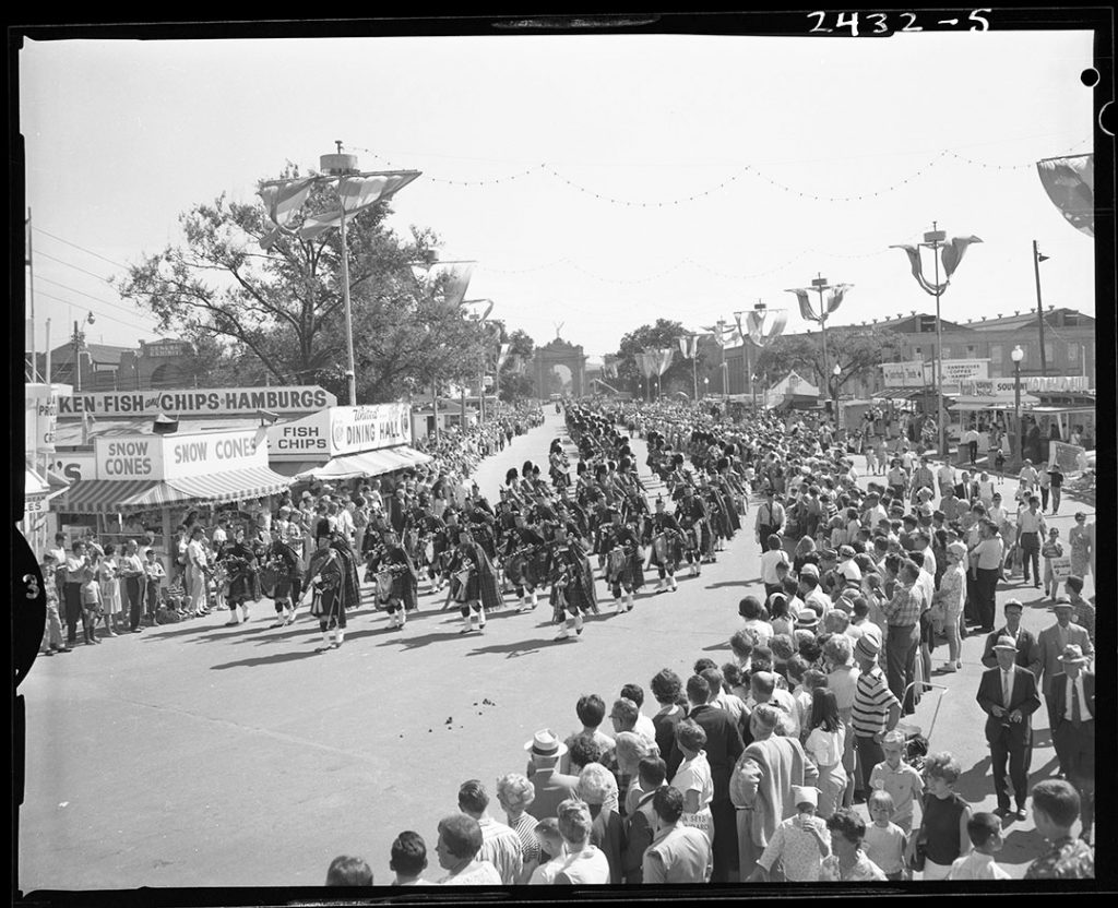 1960 - The Midway with food stands during a parade