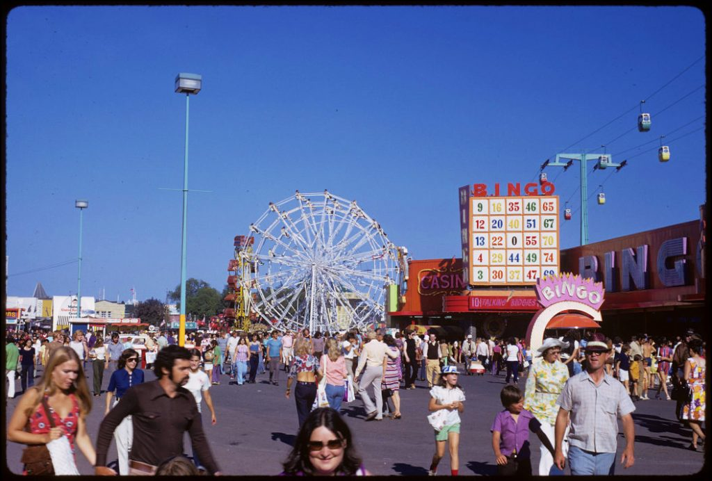 1972 - Crowds at the CNE with Ferris Wheel, Zipper, Bingo and Casino buildings in background