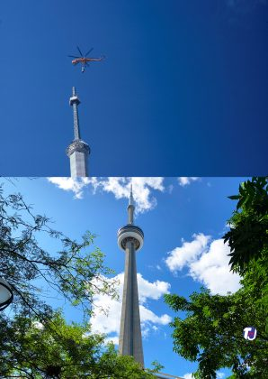 2019/1975 - CN Tower during construction with Sikorsky Helicopter lifting antenna components