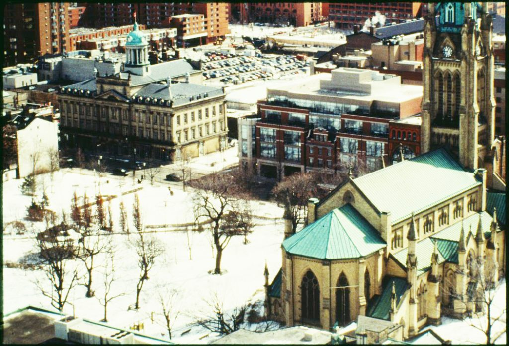1980's - Aerial view of St Lawrence Hall with the Cathedral Church of St James and Park